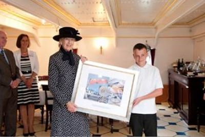 HRH Princess Alexandra is presented with an HMS Warrior 1860 gift by a student © Martin Lewis Photographer