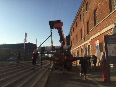 A rare bronze cannon being lifted into The National Museum of the Royal Navy